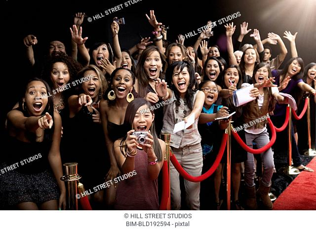 Screaming fans on the red carpet