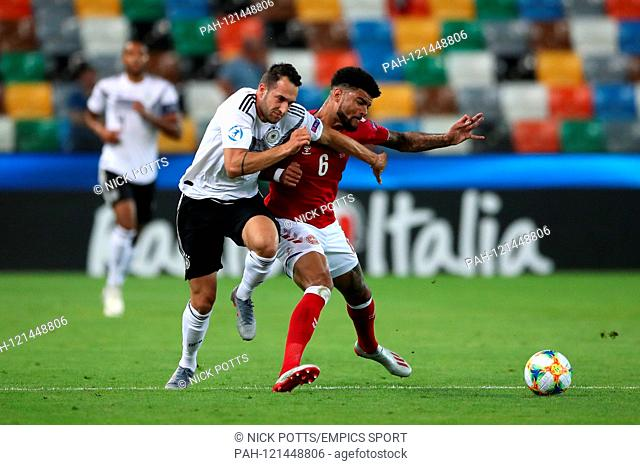 Germany U21 v Denmark U21 - European Under-21 Championship - Group B - Friuli Stadium. Germany's Levin Oztunali (left) and Denmark's Philip Billing battle for...