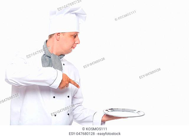 Chef with a blank space on the right and a tray on a white background