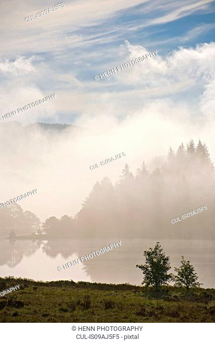 Inversion over lake Llynnau Mymbyr at sunrise, Capel Curig, Conwy, North Wales, UK