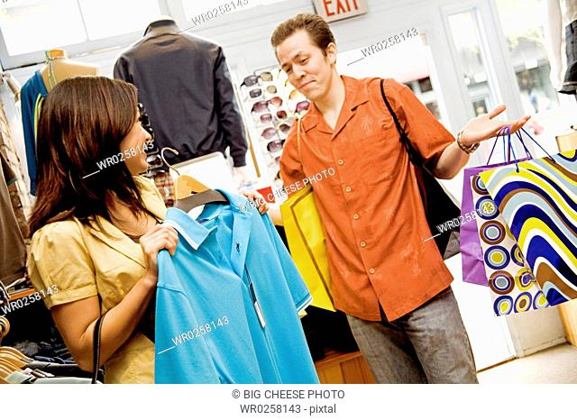 Couple shopping in clothing store