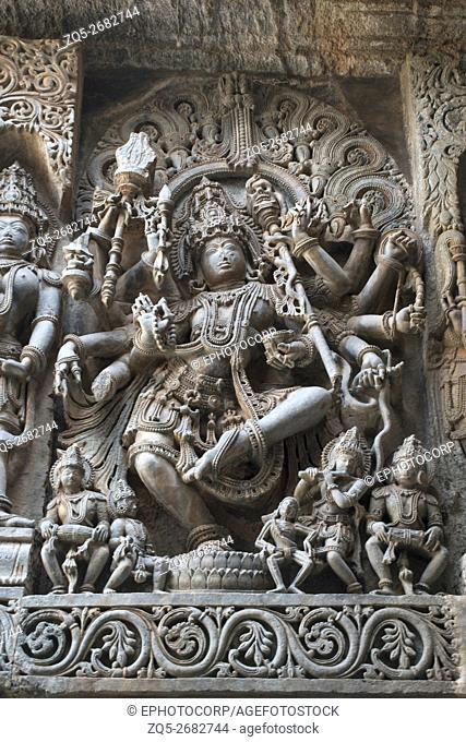 Sculpture of dancing Shiva, Hoysaleshwara temple, Halebidu, Karnataka, india. view from West