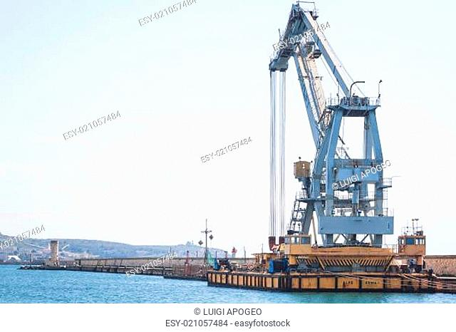 Old crane at the dock of the port
