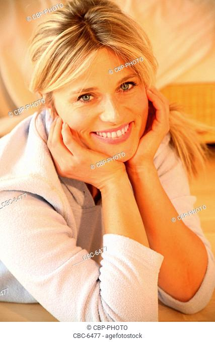 Portrait of Young Woman Relaxing at Home, Looking at Camera