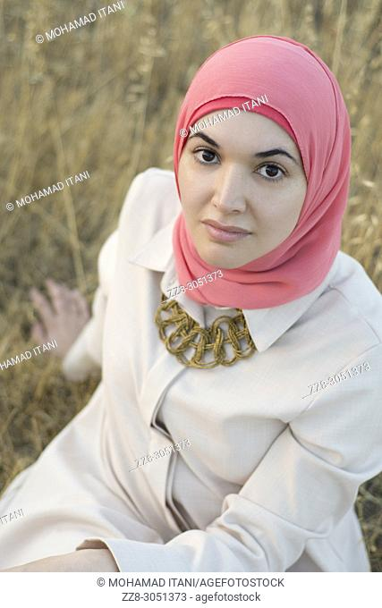 Beautiful Muslim woman staring