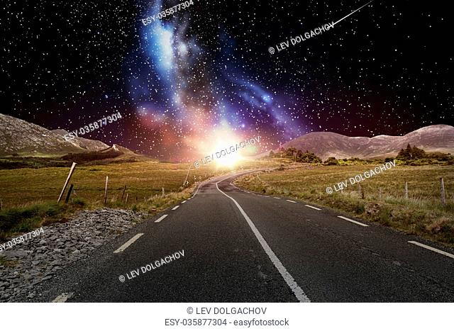 travel, astronomy and landscape concept - asphalt road over night sky or space with shooting stars background