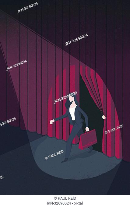 Spotlight on businesswoman on stage