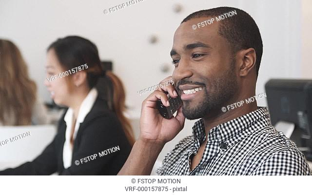 MS, A man talking on the phone in an office