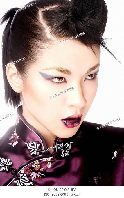 Young woman wearing cheongsam with fashion make up