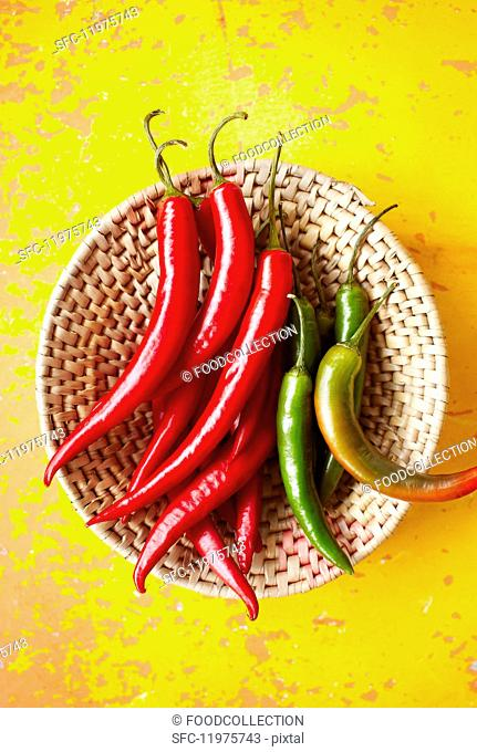 Fresh chilli peppers in a basket (seen from above)
