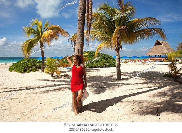 Woman at the beach, Cancun, Quintana Roo, Yucatan Province, Mexico, North America