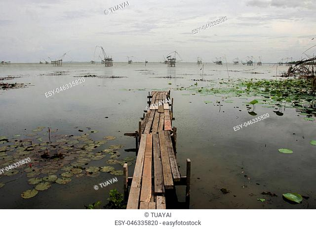 View landscape of fishing lift and dip net machine in Pakpra canal at Ban Pak Pra fishing village in dusk time at Phatthalung province of southern Thailand