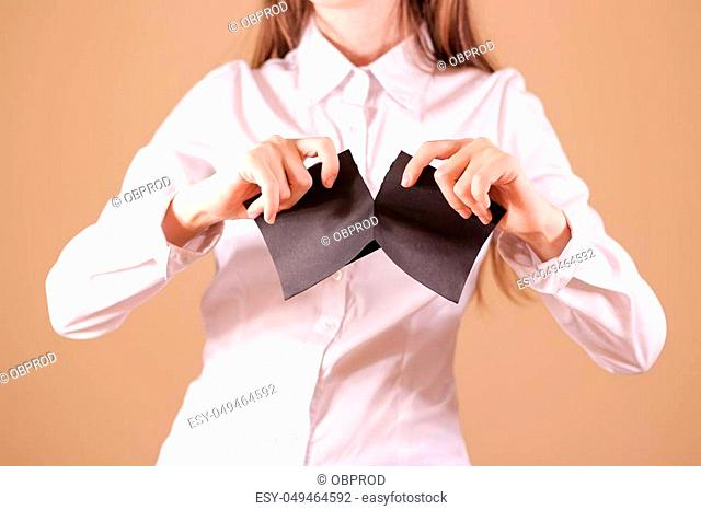 Girl tearing a piece of paper in half blank white flyer brochure booklet. Leaflet presentation. Pamphlet hold hands. Woman show clear offset paper