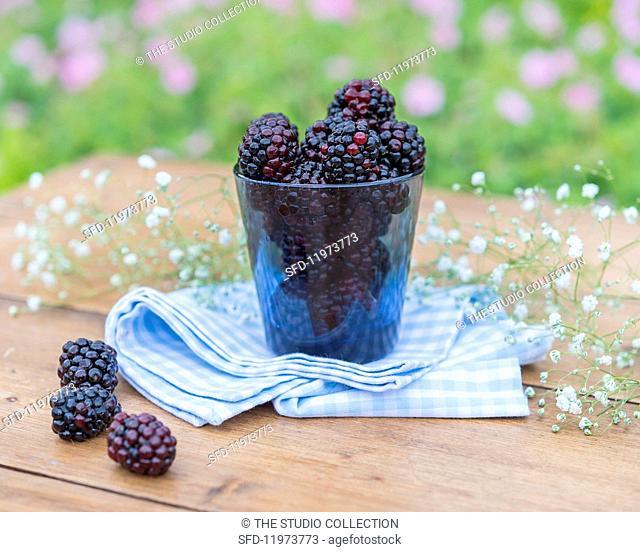 Blackberries and gypsophila on a garden table