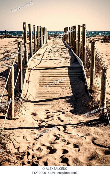 Lonely beach pathway with vintage colors