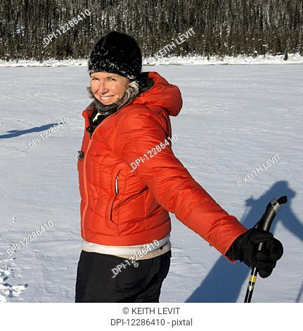 Young woman cross country skiing in Yoho National Park; Field, British Columbia, Canada