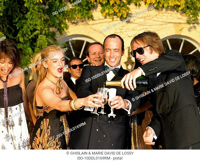People drinking champagne at sunset