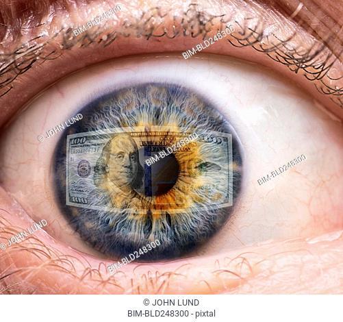 Close up of eye watching money