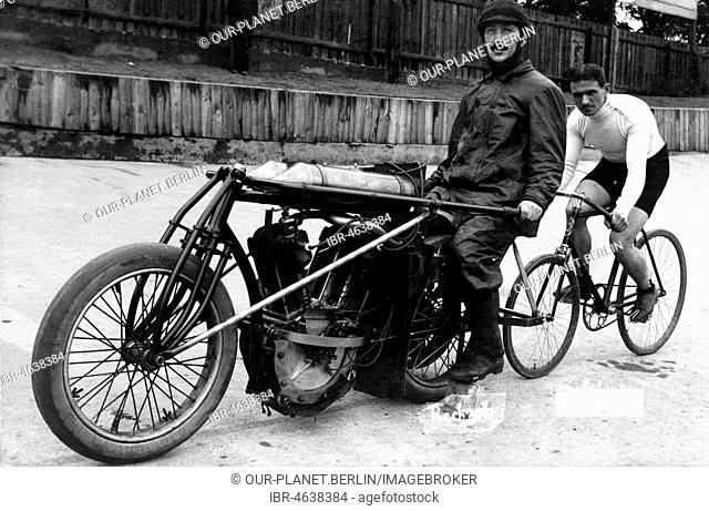 Bicycle rider in tow of a motorcyclist, ca. 1920, 1920s, exact place unknown, Germany