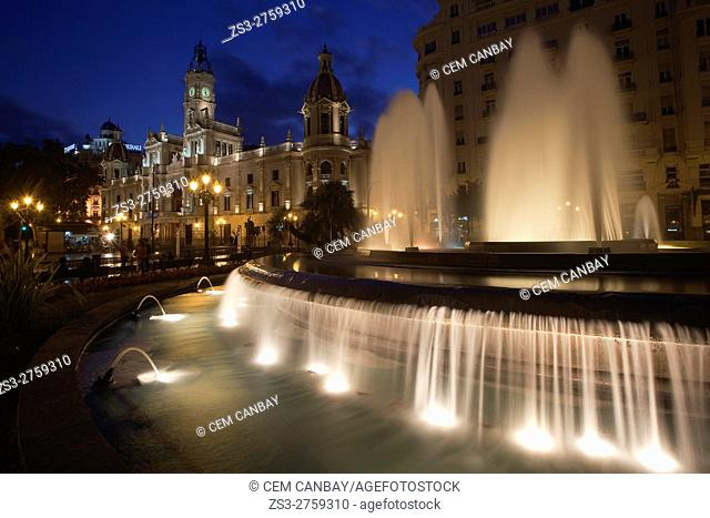 View to the Town Hall at the Plaza del Ayuntamiento square with a illuminated fountain in the foreground by night, Valencia, Spain, Europe