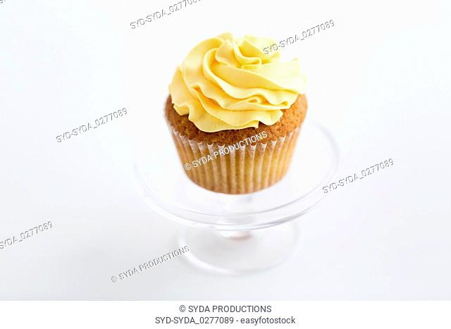 cupcake with frosting on confectionery stand