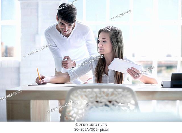 Female and male designers designing in studio