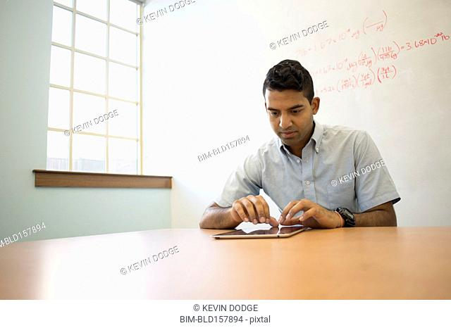 Asian businessman using digital tablet in office