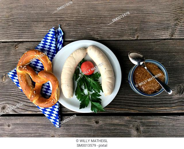 Weisswurst and pretzel for a traditional breakfast to be served and eaten before 10 o`clock in Bavaria, Germany, Europe