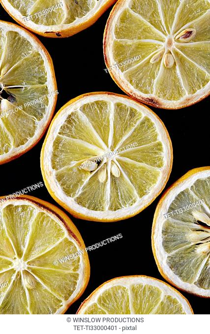Close up of dried lemon slices on black background