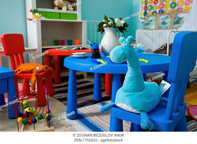baby room, giraffe toy on the chair