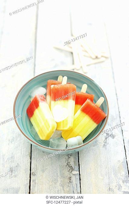 Tri-colored melon ice creams on sticks (vegan)