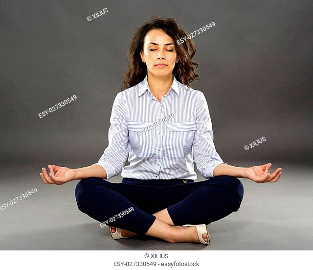 Businesswoman trying to chill out after a stressful day at work