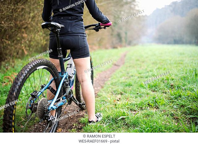 Female mountain biker on a trail