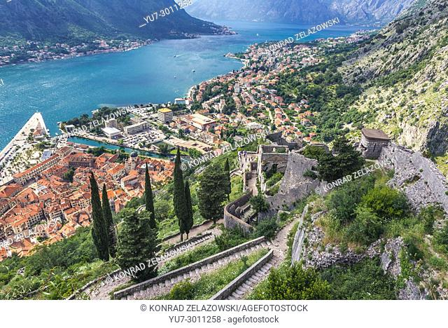Tourist path on the ancient walls to Saint John Fortress above Kotor town with aerial view on Bay of Kotor, Montenegro