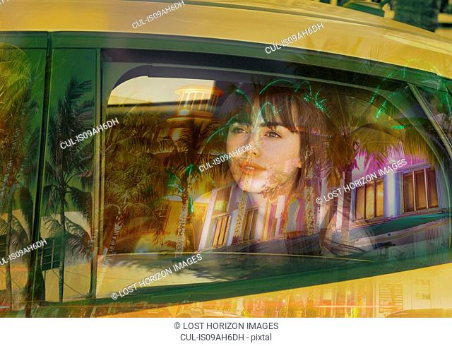 Young woman in back of taxi