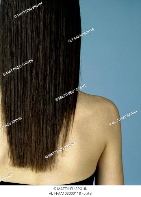 Brunette with long hair, rear view