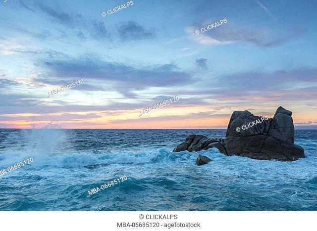 Dusk on the waves of blue sea crashing on rocks Capo Testa Santa Teresa di Gallura Province of Sassari Sardinia Italy Europe