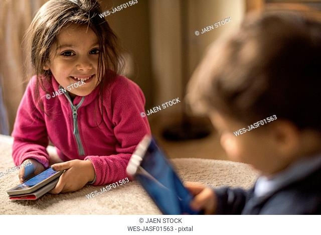 Portrait of smiling little girl with smartphone