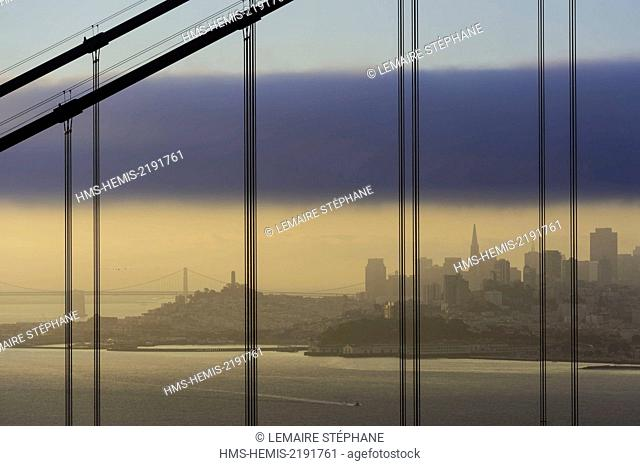 United States, California, San Francisco, San Francisco city skyline from Battery Spencer though Golden Gate Bridge cables