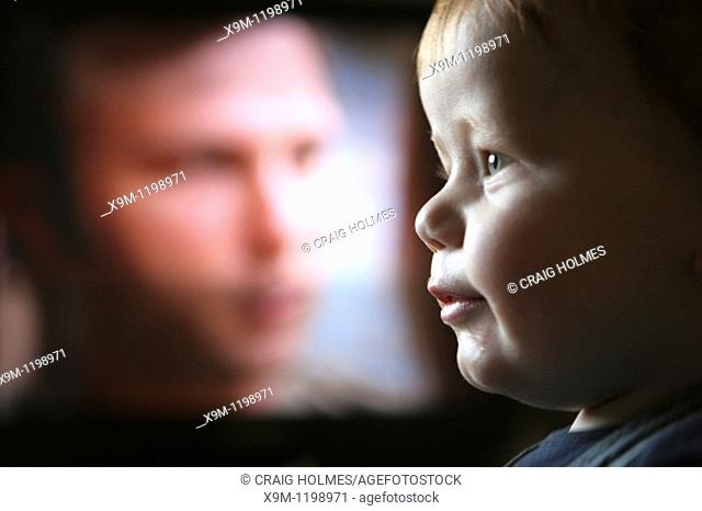 A baby watching television