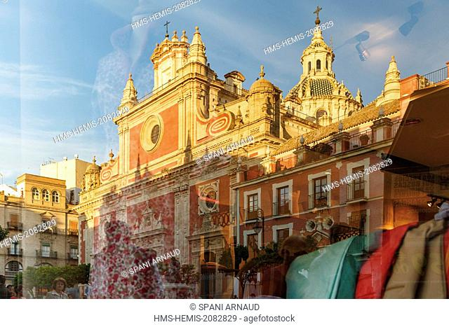Spain, Andalusia, Seville, El Salvador Place, reflection in a window of the church El Salvador at sunset