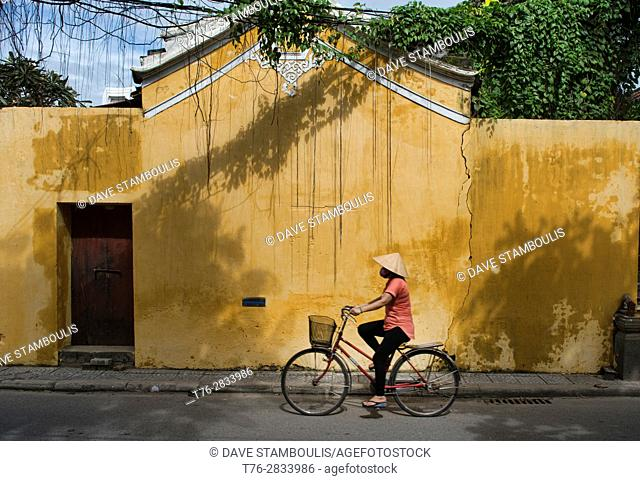 Bicycling in the picturesque old town of Hoi An, Vietnam