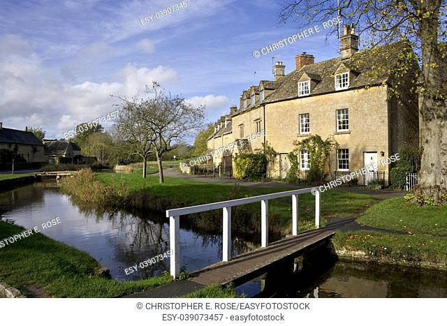 England, Gloucestershire, Cotswolds, Lower Slaughter in autumn, riverside cotswold stone cottages