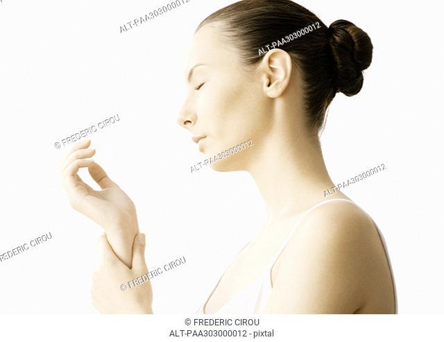 Woman massaging wrist