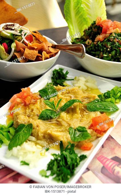 Baba Ganoush, eggplant or aubergine cream, Fattush, bread salad and tabouleh, parsley salad, Arabic mezze, appetizers in a Beirut restaurant, Beirut, Lebanon