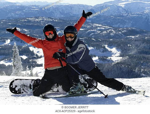 Two friends obviously enjoying themselves while snowboarding up at Mt. Washington on a sunny day. Mt. Washington, Comox Valley, Vancouver Island
