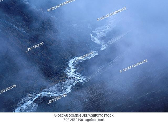 Stream in the fog. Machhermo. Sagarmatha National Park. Solukhumbu District. Nepal