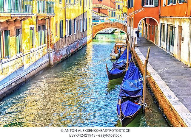 Venice gondolas in a narrow canal, no people