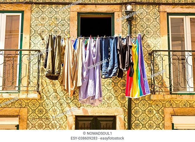 Colorful clothing is drying at the window