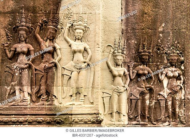 Bas-reliefs of devis on the walls of Angkor Wat, Siem Reap, Cambodia
